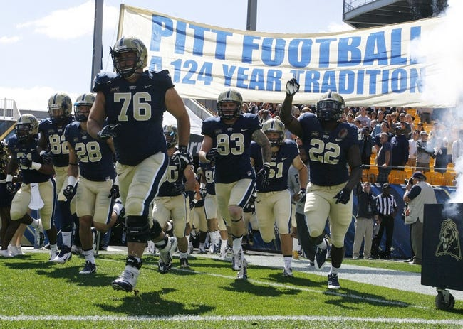Sep 14, 2013; Pittsburgh, PA, USA; The Pittsburgh Panthers take the field to play the New Mexico Lobos during the first quarter at Heinz Field. The Pittsburgh Panthers won 49-27. Mandatory Credit: Charles LeClaire-USA TODAY Sports