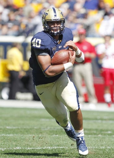Sep 14, 2013; Pittsburgh, PA, USA; Pittsburgh Panthers running back James Conner (40) carries the ball against the New Mexico Lobos during the first quarter at Heinz Field. The Pittsburgh Panthers won 49-27. Mandatory Credit: Charles LeClaire-USA TODAY Sports