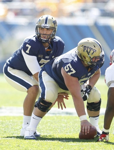 Sep 14, 2013; Pittsburgh, PA, USA; Pittsburgh Panthers quarterback Tom Savage (7) calls a play under center Artie Rowell (57) against the New Mexico Lobos during the second  quarter at Heinz Field. The Pittsburgh Panthers won 49-27. Mandatory Credit: Charles LeClaire-USA TODAY Sports