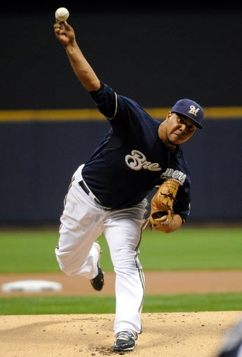 Sep 16, 2013; Milwaukee, WI, USA; Milwaukee Brewers pitcher Wily Peralta pitches against the Chicago Cubs in the first inning at Miller Park. Mandatory Credit: Benny Sieu-USA TODAY Sports