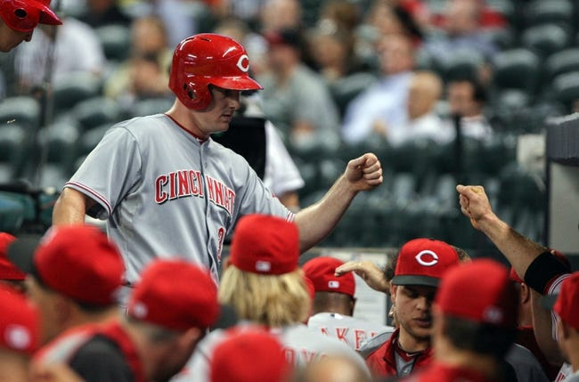 Sep 16, 2013; Houston, TX, USA; Cincinnati Reds right fielder Jay Bruce (32) is congratulated after scoring a run during the second inning against the Houston Astros at Minute Maid Park. Mandatory Credit: Troy Taormina-USA TODAY Sports