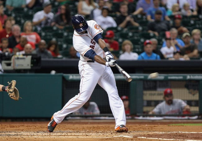 Sep 16, 2013; Houston, TX, USA; Houston Astros first baseman Chris Carter (23) hits a double during the third inning against the Cincinnati Reds at Minute Maid Park. Mandatory Credit: Troy Taormina-USA TODAY Sports
