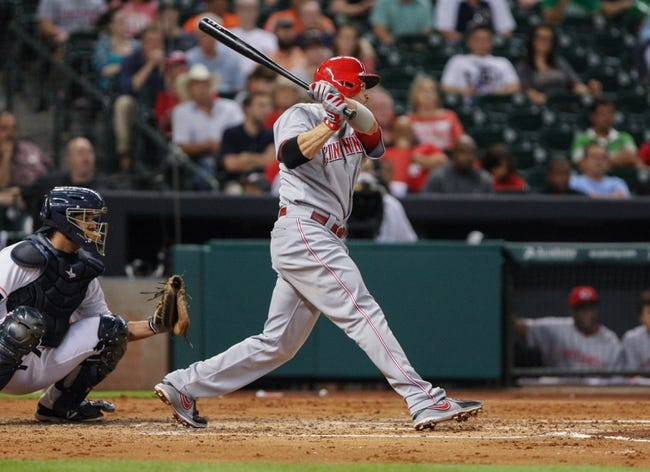 Sep 16, 2013; Houston, TX, USA; Cincinnati Reds first baseman Joey Votto (19) gets a single during the fourth inning against the Houston Astros at Minute Maid Park. Mandatory Credit: Troy Taormina-USA TODAY Sports
