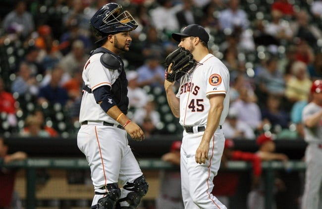 Sep 16, 2013; Houston, TX, USA; Houston Astros catcher Carlos Corporan (22) talks to starting pitcher Erik Bedard (45) during the fourth inning against the Cincinnati Reds at Minute Maid Park. Mandatory Credit: Troy Taormina-USA TODAY Sports