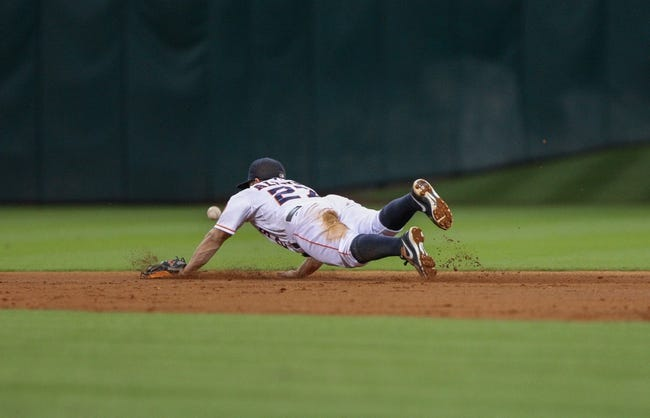 Sep 16, 2013; Houston, TX, USA; Houston Astros second baseman Jose Altuve (27) dives for a ground ball during the fifth inning against the Cincinnati Reds at Minute Maid Park. Mandatory Credit: Troy Taormina-USA TODAY Sports