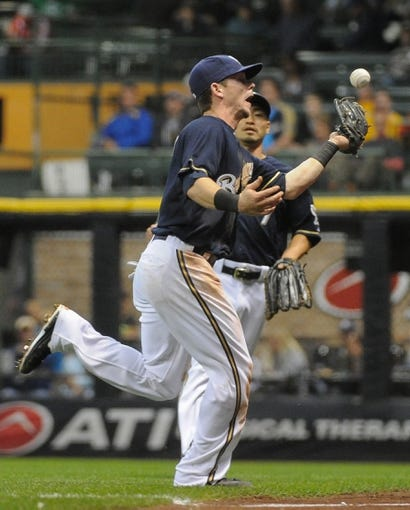 Sep 16, 2013; Milwaukee, WI, USA;  Milwaukee Brewers second baseman Scooter Gennett can't catch a ball that was hit by Chicago Cubs catcher Welington Castillo (not pictured) and was ruled a double in the fifth inning at Miller Park. Mandatory Credit: Benny Sieu-USA TODAY Sports