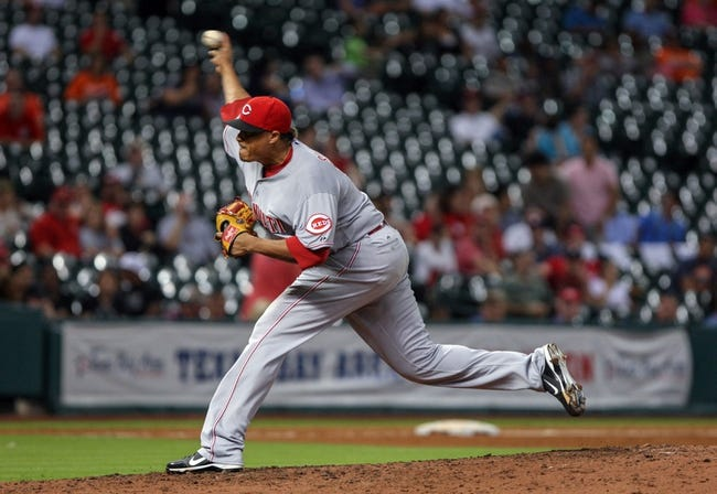 Sep 16, 2013; Houston, TX, USA; Cincinnati Reds relief pitcher Alfredo Simon (31) pitches during the sixth inning against the Houston Astros at Minute Maid Park. Mandatory Credit: Troy Taormina-USA TODAY Sports