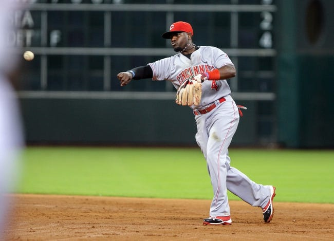 Sep 16, 2013; Houston, TX, USA; Cincinnati Reds second baseman Brandon Phillips (4) throws to first base during the sixth inning against the Houston Astros at Minute Maid Park. Mandatory Credit: Troy Taormina-USA TODAY Sports