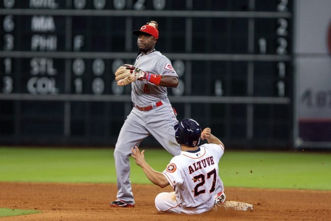 Sep 16, 2013; Houston, TX, USA; Houston Astros second baseman Jose Altuve (27) is out at second base as Cincinnati Reds second baseman Brandon Phillips (4) fields the throw during the eighth inning at Minute Maid Park. Mandatory Credit: Troy Taormina-USA TODAY Sports