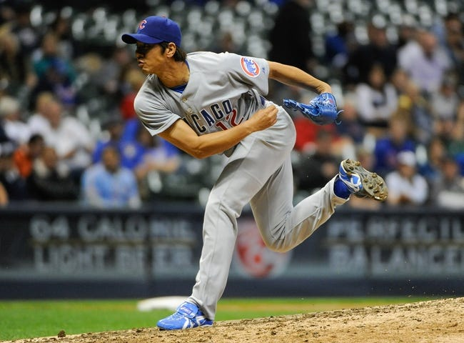 Sep 16, 2013; Milwaukee, WI, USA;  Chicago Cubs pitcher Chang-Yong Lim pitches in the sixth inning against the Milwaukee Brewers at Miller Park. Mandatory Credit: Benny Sieu-USA TODAY Sports