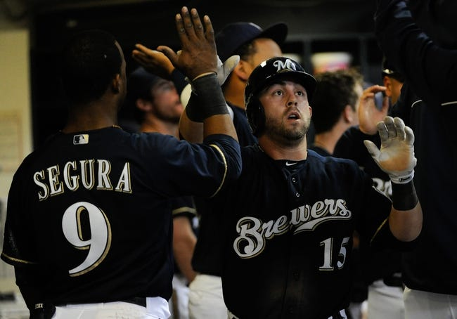 Sep 16, 2013; Milwaukee, WI, USA; Milwaukee Brewers left fielder Caleb Gindl (right) is greeted by shortstop Jean Segura after hitting a 2-run homer in the seventh inning against the Chicago Cubs at Miller Park. Mandatory Credit: Benny Sieu-USA TODAY Sports