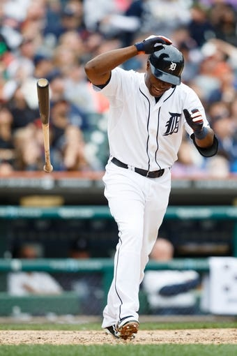 Sep 15, 2013; Detroit, MI, USA; Detroit Tigers right fielder Torii Hunter (48) reacts after popping up in the sixth inning against the Kansas City Royals at Comerica Park. Mandatory Credit: Rick Osentoski-USA TODAY Sports
