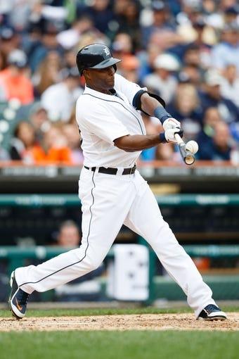 Sep 15, 2013; Detroit, MI, USA; Detroit Tigers right fielder Torii Hunter (48) at bat against the Kansas City Royals at Comerica Park. Mandatory Credit: Rick Osentoski-USA TODAY Sports