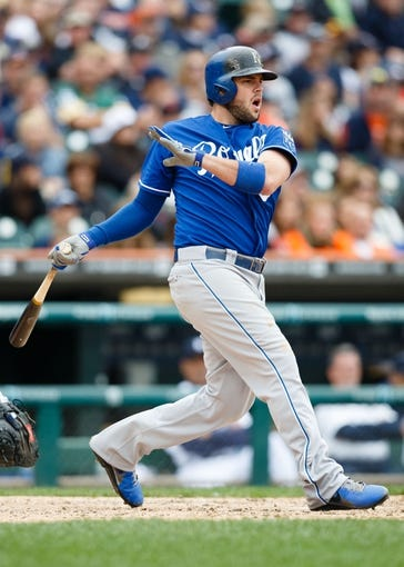 Sep 15, 2013; Detroit, MI, USA; Kansas City Royals third baseman Mike Moustakas (8) hits a double in the seventh inning against the Detroit Tigers at Comerica Park. Mandatory Credit: Rick Osentoski-USA TODAY Sports