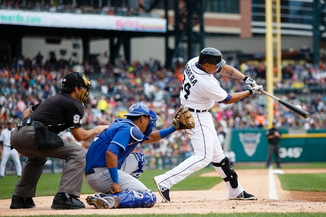 Sep 15, 2013; Detroit, MI, USA; Detroit Tigers third baseman Miguel Cabrera (24) hits a single in the first inning against the Kansas City Royals at Comerica Park. Mandatory Credit: Rick Osentoski-USA TODAY Sports