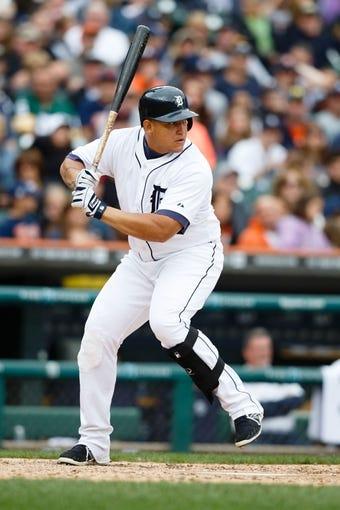 Sep 15, 2013; Detroit, MI, USA; Detroit Tigers third baseman Miguel Cabrera (24) at bat against the Kansas City Royals at Comerica Park. Mandatory Credit: Rick Osentoski-USA TODAY Sports