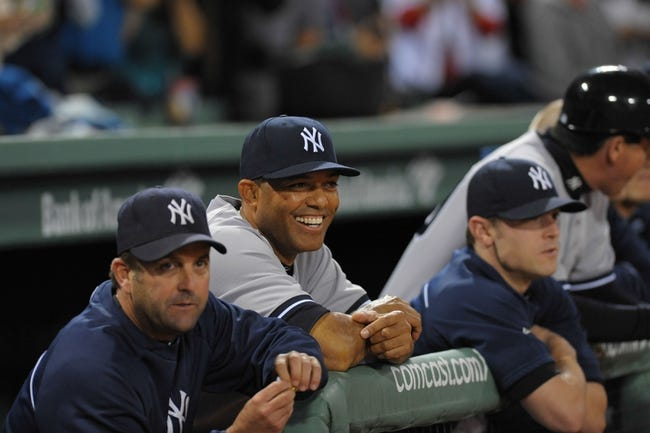 Sep 15, 2013; Boston, MA, USA; New York Yankees relief pitcher Mariano Rivera (42) shares a laugh in the dugout during pre-game ceremonies in his honor prior to the start of a game against the Boston Red Sox at Fenway Park. Mandatory Credit: Bob DeChiara-USA TODAY Sports