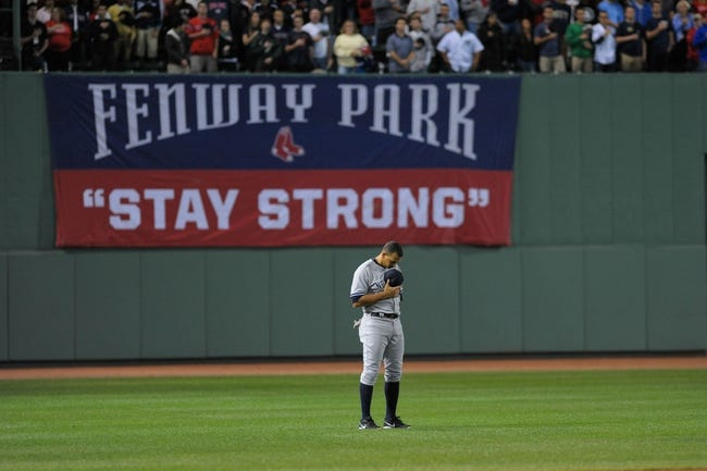 Sep 15, 2013; Boston, MA, USA; New York Yankees third baseman Alex Rodriguez (13) pays tribute to the national anthem prior to a game against the Boston Red Sox at Fenway Park. Mandatory Credit: Bob DeChiara-USA TODAY Sports