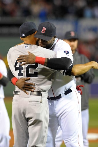 Sep 15, 2013; Boston, MA, USA; Boston Red Sox designated hitter David Ortiz (34) hugs New York Yankees relief pitcher Mariano Rivera (42) during pre-game ceremonies at Fenway Park. Mandatory Credit: Bob DeChiara-USA TODAY Sports