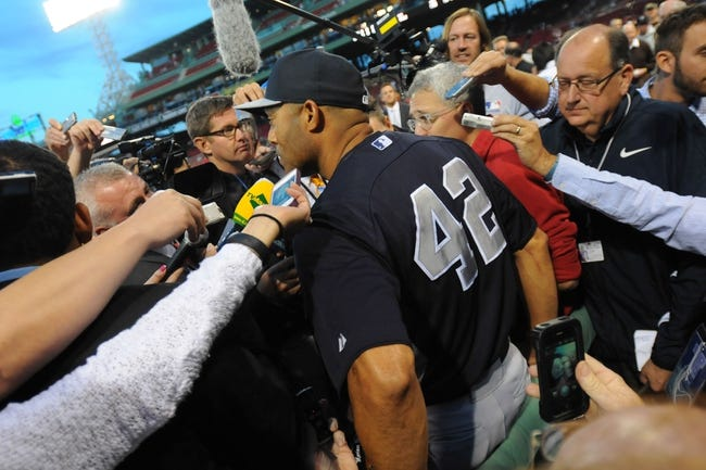 Sep 15, 2013; Boston, MA, USA; New York Yankees relief pitcher Mariano Rivera (42) talks to reporters prior to a game against the Boston Red Sox at Fenway Park. Mandatory Credit: Bob DeChiara-USA TODAY Sports