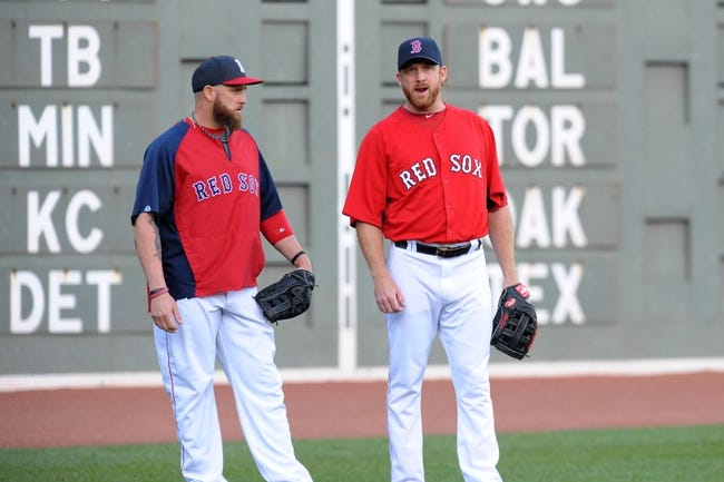 Sep 15, 2013; Boston, MA, USA; Boston Red Sox left fielder Jonny Gomes (5) and starting pitcher Ryan Dempster (46) chat during batting practice prior to a game against the New York Yankees at Fenway Park. Mandatory Credit: Bob DeChiara-USA TODAY Sports
