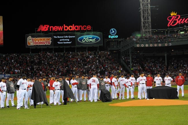 Sep 15, 2013; Boston, MA, USA; Members of the Boston Red Sox await to present gifts to New York Yankees relief pitcher Mariano Rivera (not pictured) who was being honored prior to the start of the game at Fenway Park. Mandatory Credit: Bob DeChiara-USA TODAY Sports