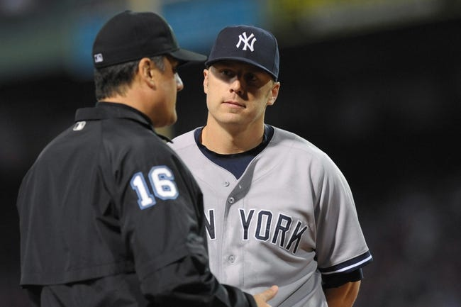 Sep 15, 2013; Boston, MA, USA; New York Yankees third baseman Mark Reynolds (39) talks with third base umpire Mike DiMuro during the fifth inning against the Boston Red Sox at Fenway Park. Mandatory Credit: Bob DeChiara-USA TODAY Sports