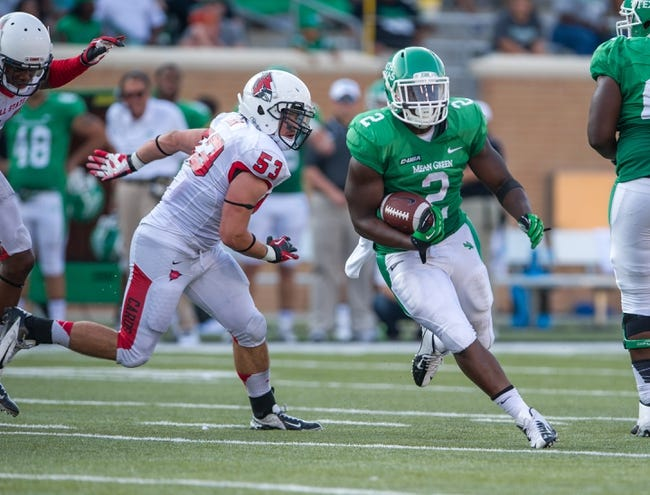 Sep 14, 2013; Denton, TX, USA; North Texas Mean Green running back Reggie Pegram (2) eludes Ball State Cardinals linebacker Zack Ryan (53) during the game at Apogee Stadium. The Mean Green defeated the Cardinals 34-27. Mandatory Credit: Jerome Miron-USA TODAY Sports