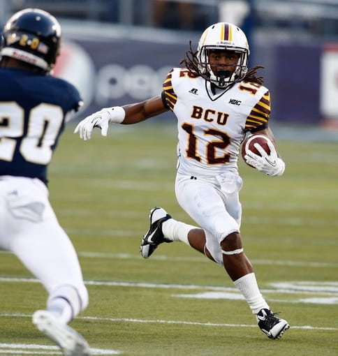 Sep 14, 2013; Miami, FL, USA;  Bethune Cookman Wildcats wide receiver Preston Cleckley (12) runs with the ball in a game against the Florida International Panthers in the second quarter at FIU Stadium. Mandatory Credit: Robert Mayer-USA TODAY Sports