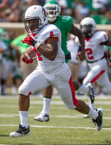 Sep 14, 2013; Denton, TX, USA; Ball State Cardinals running back Horactio Banks (4) runs against the North Texas Mean Green during the game at Apogee Stadium. The Mean Green defeated the Cardinals 34-27. Mandatory Credit: Jerome Miron-USA TODAY Sports