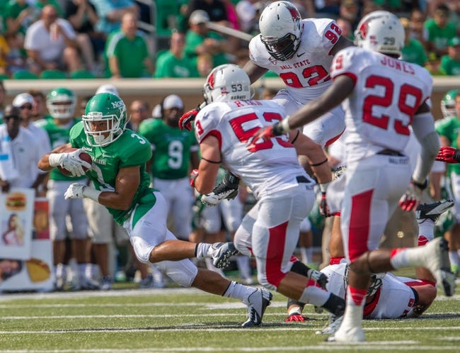 Sep 14, 2013; Denton, TX, USA; North Texas Mean Green wide receiver Brelan Chancellor (3) eludes the Ball State Cardinals defense during the game at Apogee Stadium. The Mean Green defeated the Cardinals 34-27. Mandatory Credit: Jerome Miron-USA TODAY Sports