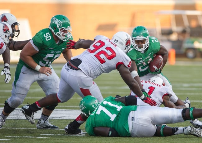 Sep 14, 2013; Denton, TX, USA; Ball State Cardinals defensive tackle Nathan Ollie (92) tackles North Texas Mean Green running back Brandin Byrd (24) during the game at Apogee Stadium. The Mean Green defeated the Cardinals 34-27. Mandatory Credit: Jerome Miron-USA TODAY Sports