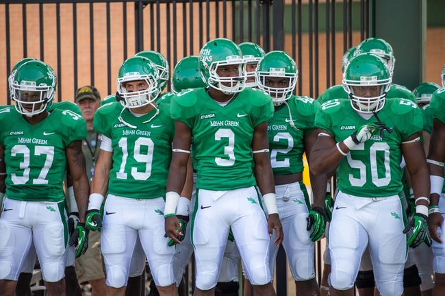 Sep 14, 2013; Denton, TX, USA; The North Texas Mean Green prepare to take the field to face the Ball State Cardinals at Apogee Stadium. The Mean Green defeated the Cardinals 34-27. Mandatory Credit: Jerome Miron-USA TODAY Sports