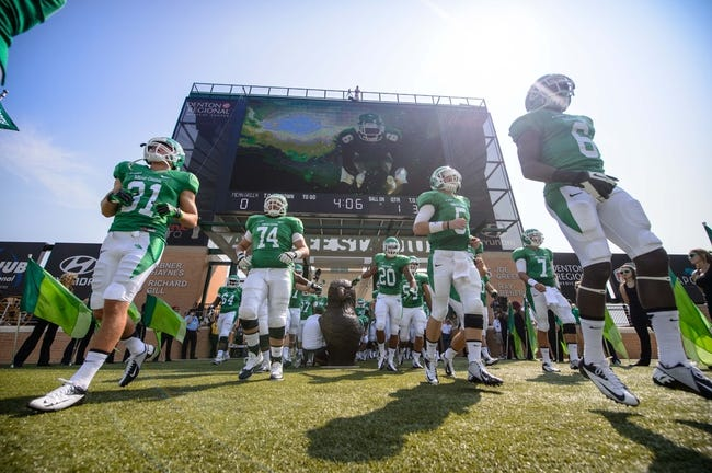 Sep 14, 2013; Denton, TX, USA; The North Texas Mean Green take the field to face the Ball State Cardinals at Apogee Stadium. The Mean Green defeated the Cardinals 34-27. Mandatory Credit: Jerome Miron-USA TODAY Sports
