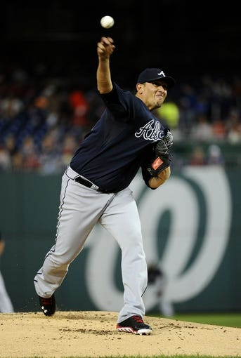 Sep 17, 2013; Washington, DC, USA; Atlanta Braves starting pitcher Freddy Garcia (50) throws during the first inning against the Washington Nationals at Nationals Park. Mandatory Credit: Brad Mills-USA TODAY Sports