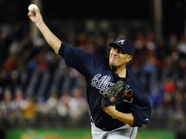 Sep 17, 2013; Washington, DC, USA; Atlanta Braves starting pitcher Freddy Garcia (50) throws during the second inning against the Washington Nationals at Nationals Park. Mandatory Credit: Brad Mills-USA TODAY Sports