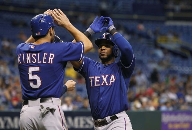 Sep 17, 2013; St. Petersburg, FL, USA; Texas Rangers shortstop Elvis Andrus (1) is congratulated by second baseman Ian Kinsler (5) at home plate after hitting a two run home run during the third inning against the Tampa Bay Rays at Tropicana Field. Mandatory Credit: Kim Klement-USA TODAY Sports