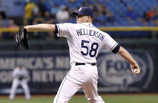 Sep 17, 2013; St. Petersburg, FL, USA; Tampa Bay Rays starting pitcher Jeremy Hellickson (58) throws a pitch during the third inning against the Texas Rangers at Tropicana Field. Mandatory Credit: Kim Klement-USA TODAY Sports