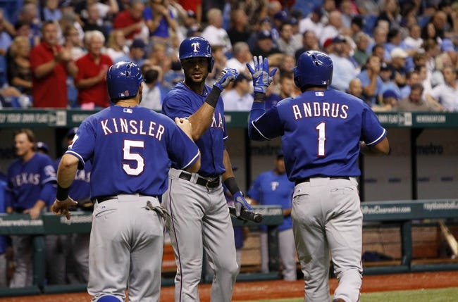 Sep 17, 2013; St. Petersburg, FL, USA; Texas Rangers shortstop Elvis Andrus (1) and second baseman Ian Kinsler (5) are congratulated by right fielder Alex Rios (51) after Andrus hit a two run home run during the third inning against the Tampa Bay Rays at Tropicana Field. Mandatory Credit: Kim Klement-USA TODAY Sports