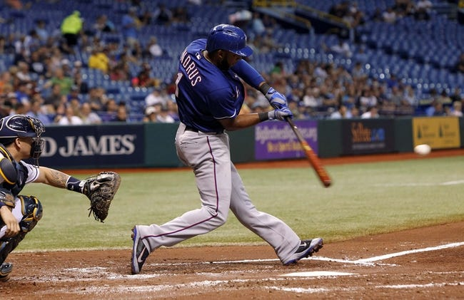Sep 17, 2013; St. Petersburg, FL, USA; Texas Rangers shortstop Elvis Andrus (1) hits a two run home run during the third inning against the Tampa Bay Rays at Tropicana Field. Mandatory Credit: Kim Klement-USA TODAY Sports