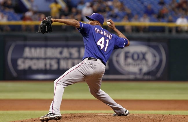 Sep 17, 2013; St. Petersburg, FL, USA; Texas Rangers starting pitcher Alexi Ogando (41) throws a pitch during the third inning against the Tampa Bay Rays at Tropicana Field. Mandatory Credit: Kim Klement-USA TODAY Sports