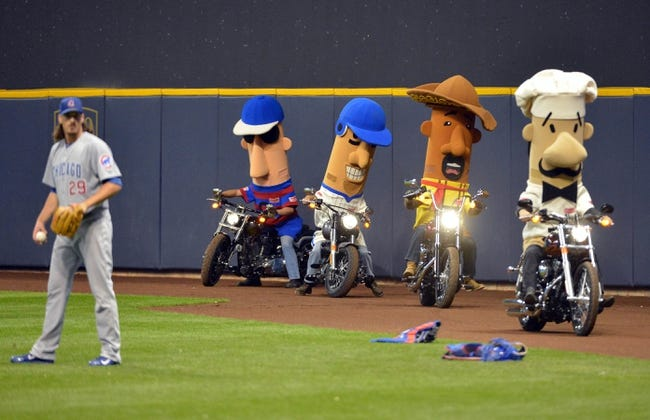Sep 17, 2013; Milwaukee, WI, USA;   The Racing Sausages ride on Harley Davidson motorcycles as Chicago Cubs pitcher Jeff Samardzija (left) warms up before game against the Milwaukee Brewers at Miller Park. Mandatory Credit: Benny Sieu-USA TODAY Sports
