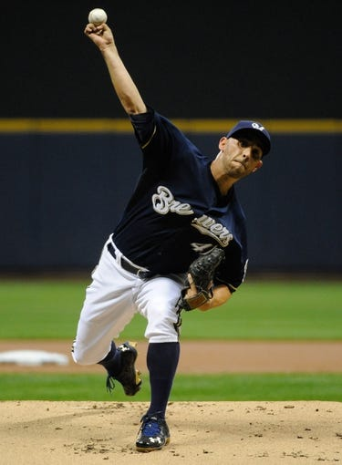 Sep 17, 2013; Milwaukee, WI, USA;   Milwaukee Brewers pitcher Marco Estrada pitches against the Chicago Cubs in the 1st inning at Miller Park. Mandatory Credit: Benny Sieu-USA TODAY Sports