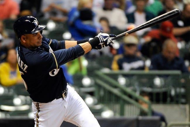 Sep 17, 2013; Milwaukee, WI, USA;   Milwaukee Brewers third baseman Aramis Ramirez hits a double in the second inning during the game against the Chicago Cubs at Miller Park. Mandatory Credit: Benny Sieu-USA TODAY Sports