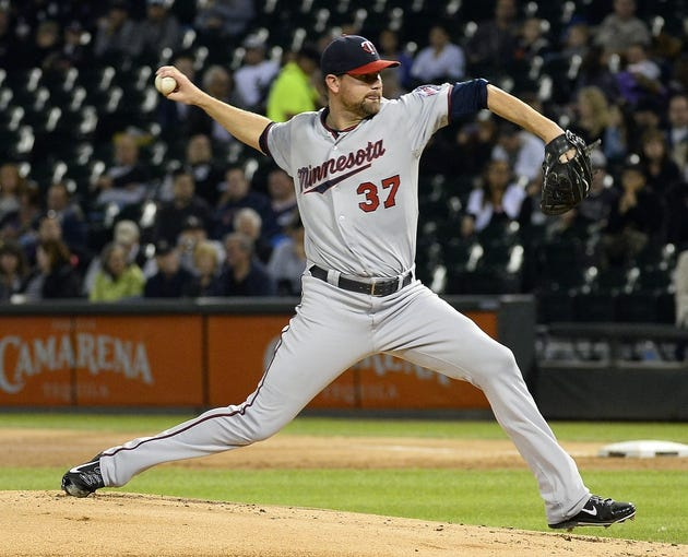 Sep 17, 2013; Chicago, IL, USA; Minnesota Twins starting pitcher Mike Pelfrey (37) throws a pitch against the Chicago White Sox during the first inning at U.S Cellular Field. Mandatory Credit: Mike DiNovo-USA TODAY Sports