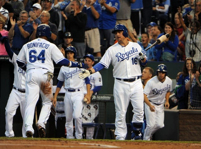 Sep 17, 2013; Kansas City, MO, USA; Kansas City Royals second baseman Emilio Bonifacio (64) is congratulated by designated hitter Billy Butler (16) after scoring in the first inning against the Cleveland Indians at Kauffman Stadium. Mandatory Credit: John Rieger-USA TODAY Sports