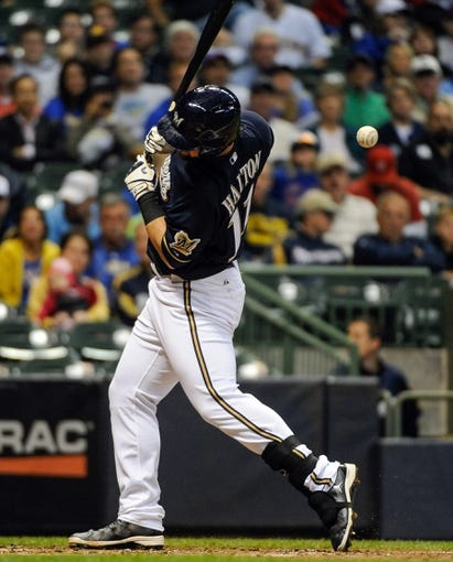 Sep 17, 2013; Milwaukee, WI, USA;  Milwaukee Brewers first baseman Sean Halton is hit by a pitch from Chicago Cubs pitcher Jeff Samardzija (not pictured) in the second inning at Miller Park. Mandatory Credit: Benny Sieu-USA TODAY Sports