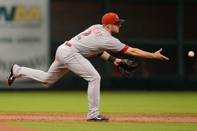 Sep 17, 2013; Houston, TX, USA; Cincinnati Reds shortstop Zack Cozart (2) throws the ball to second base against the Houston Astros during the first inning at Minute Maid Park. Mandatory Credit: Thomas Campbell-USA TODAY Sports