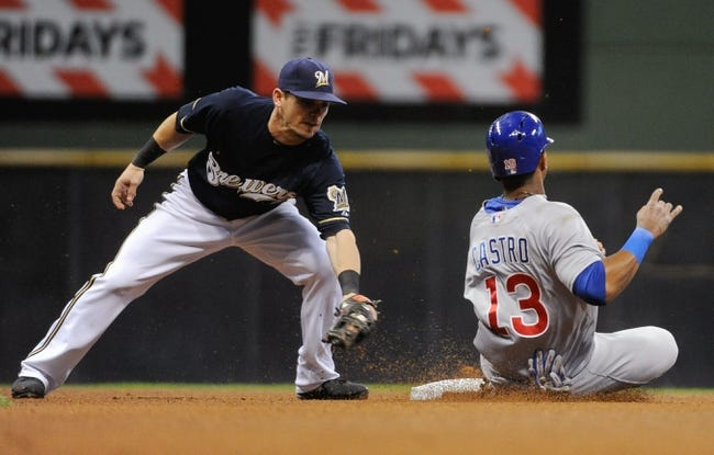 Sep 17, 2013; Milwaukee, WI, USA; Chicago Cubs shortstop Starlin Castro (right) steals second base in front of Milwaukee Brewers second baseman Scooter Gennett (left) in the fourth inning at Miller Park. Mandatory Credit: Benny Sieu-USA TODAY Sports