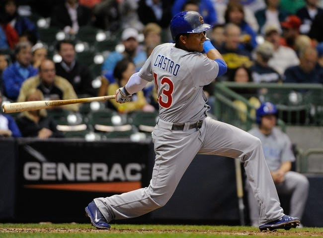 Sep 17, 2013; Milwaukee, WI, USA; Chicago Cubs shortstop Starlin Castro hits a single in the fourth inning during the game against the Milwaukee Brewers at Miller Park. Mandatory Credit: Benny Sieu-USA TODAY Sports